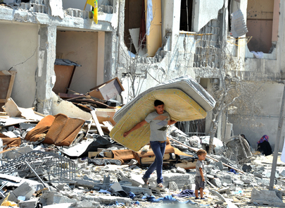 Palestinians Search through Rubble in Gaza