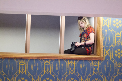 UN Photographer in Action at Security Council Meeting