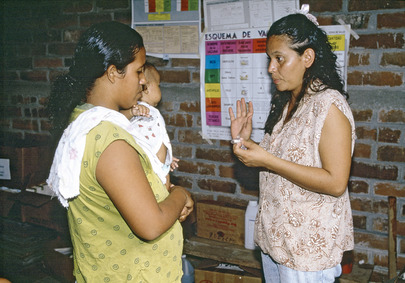 Volunteer Provides Health Information to Salvadoran Mother