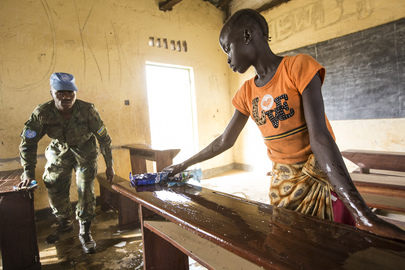 Rwandan Battalion Helps Local Community Clean School