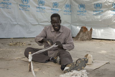 Man Fixes Fishing Net in Leer, South Sudan