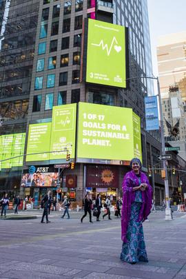 Deputy Secretary-General in front of SDGs in Times Square
