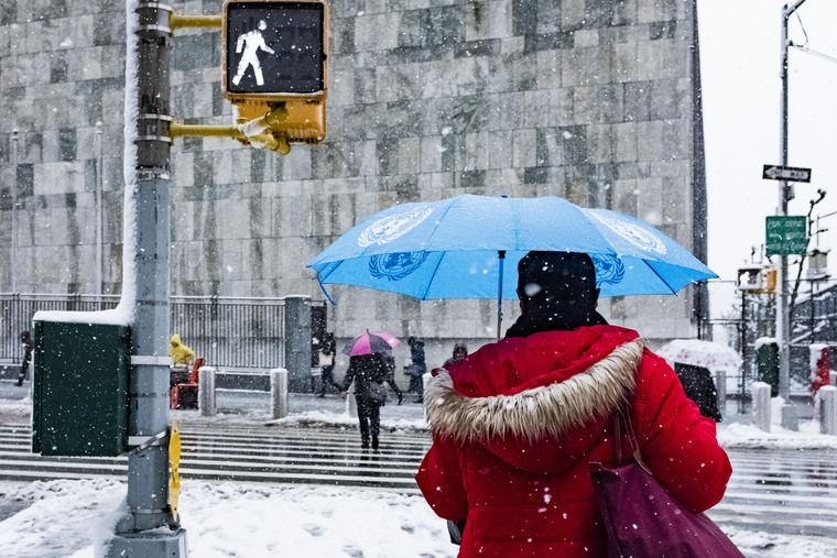 Staff Members Arrive at UNHQ on Stormy Day