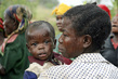 Batwa Woman with Child in Burundi 8.036474