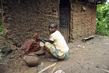 Batwa Woman Prepping Clay to Make Pots in Murwi, Burundi 8.444455