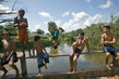 National Tapajos Forest Young Residents Play on Bridge 0.82219577