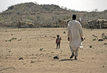 Nomad and His Son in Darfur 4.436053