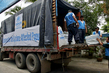 UNHCR Staff Load Shelter Supplies for Cyclone Survivors 0.5495863