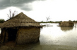 Mud Houses Surrounded by Floodwaters 4.4393754