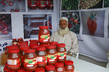 Farmer Displays Goods at Agricultural Trade Fair 8.085295