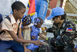 MINUSTAH Peacekeepers Distribute Food to Children 7.9353046