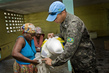 MINUSTAH Peacekeeper Distributes Food Ration 7.968431