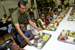 MINUSTAH Peacekeeper Serves Food to Children 8.009379