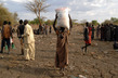IDPs Carry Bags of WFP Food Rations 6.977059