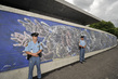 UN Security Officer Deployed on Peace Mural Security Detail 13.139305