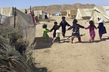 Children Play at Sosmaqala IDP Camp in Afghanistan 9.822254
