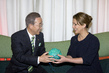Secretary-General Hands Off Signed Ball to Princess of Jordan 9.531537