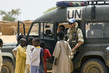 Peacekeeper with Sudanese Refugee Children 5.6572685