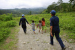 Timor Police Team Visits Victims, House by House 7.2612524