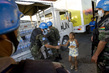 Bolivian Peacekeepers Distribute Water and Food 3.440824
