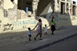 Port-au-Prince Marks One-Month Anniversary of Devastating Quake 7.459708