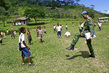 UNMIT Officer Joins in Football Game with Village Children 9.90951