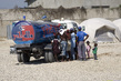 Yéle Haiti Foundation Delivers Water to New Camp 1.2373487