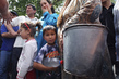Uzbek Refugees Queue for Water, Displaced by Violence in Kyrgyzstan 7.8156433