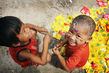 Children Play with Garbage in Cambodia Slum 8.450349