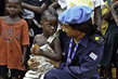 UNMIL Peacekeeper Talks with Young Girl 4.6910233