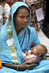 Mother and Child at Community Clinic in Rural Bangladesh 10.848127