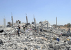 Palestinians Search through Rubble in Gaza 0.31772614
