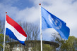 UN and Dutch Flags Fly Outside Catsuis, Netherlands 3.4715347