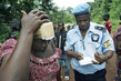 UNOCI Civilian Police Officer Helps Civilians 7.060211